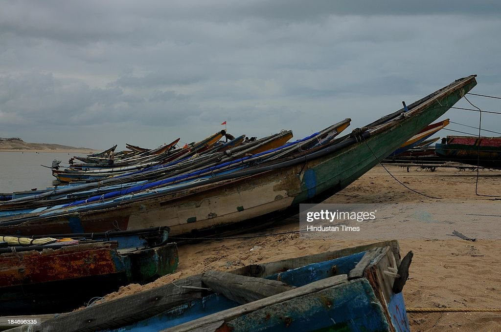 Fishermen boat parked on seacoasts at Gopalpur after the cyclone Phailin on October 15, 2013 in Chattapur, India. Cyclone Phailin on Sunday left a trail of destruction knocking down lakhs of homes affecting nearly 90 lakh people and destroying paddy crops worth about Rs 2,400 crore, but Odisha and Andhra Pradesh escaped from widespread loss of life due to timely and efficient evacuation efforts .