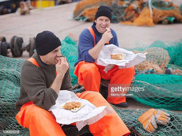 Fishermen eating fish and chips