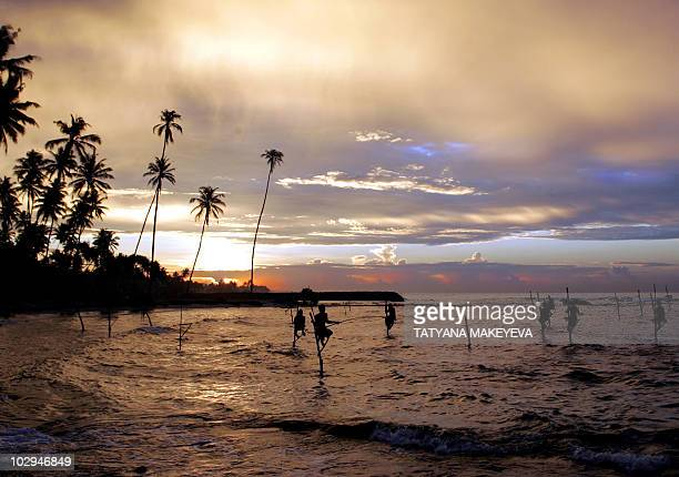 fishermen fish at sunrise in the bay near Matora south of Colombo 04 February 2005 Nearly 31000 people died in the December 26 tsunami tragedy that...