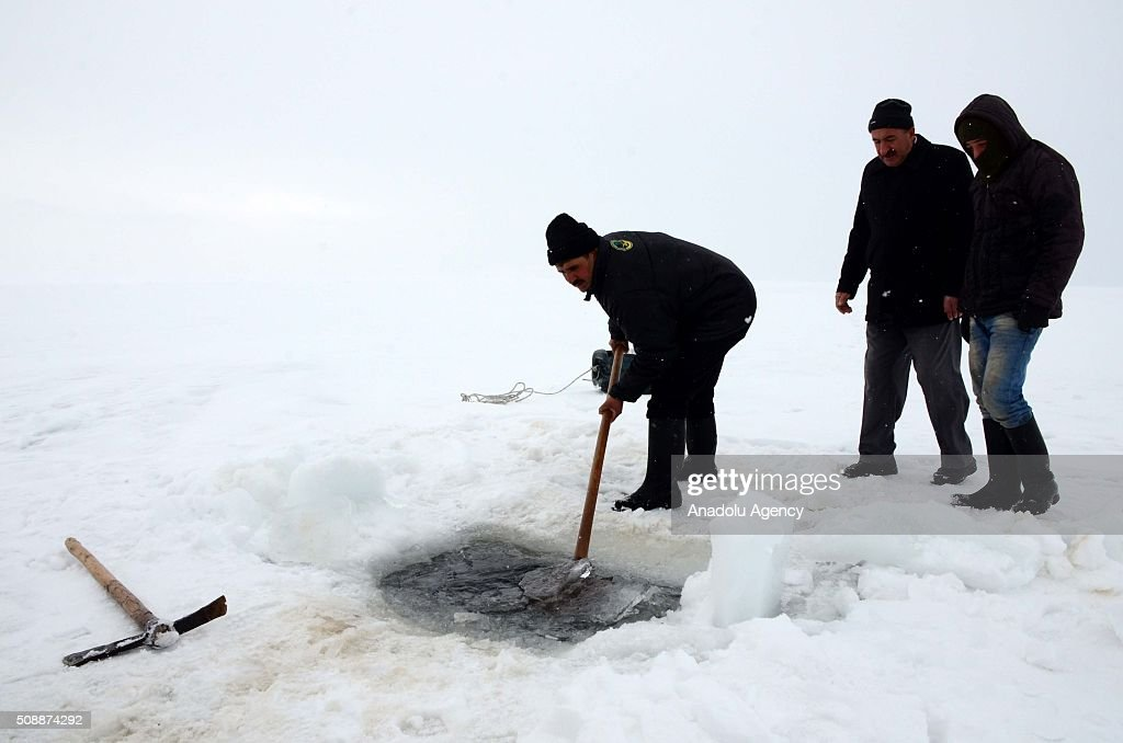 Fishermen fish over the frozen 'Nazik Lake' in Ahlat District of Bitlis, Turkey on February 07, 2016. The lake's is being frozen about 50cm every winter season due to cold weather.