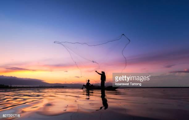Fishermen fishing in the early morning golden light