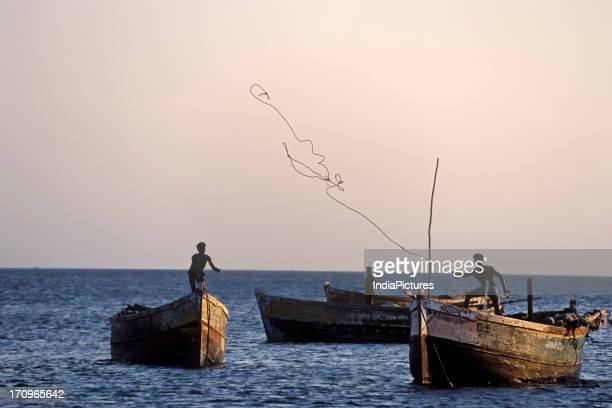 Fishermen fishing in the sea Dhanushkodi a village at the southern tip of the Rameswaram island at the eastern coast of Tamil Nadu India