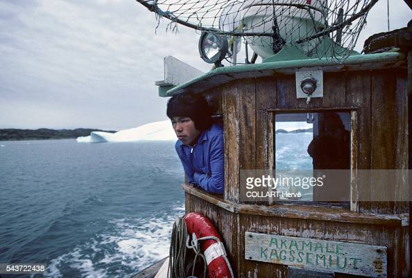 Fishermen from the village of Kagssemiut Acculturated by the Danes throughout the 20th century the Inuit gave up fishing with kayaks Too hard too...