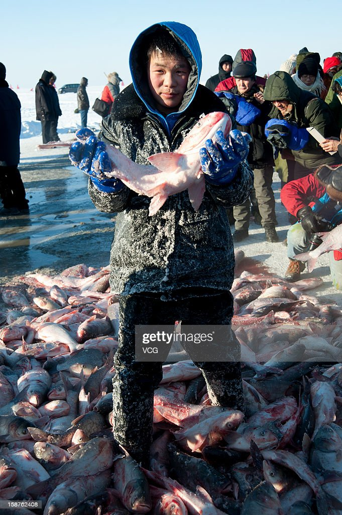 Fishermen have a big harvest on the frozen Chagan Lake on December 26, 2012 in Songyuan, China. Traditional winter fishing in the Chagan Lake, the biggest freshwater lake in Jilin province, kicked off on Thursday. It usually lasts about two months and has been popular for more than 1,000 years.
