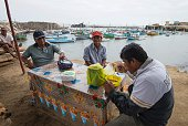Fishermen have lunch after the morning shift in Islilla Piura northern Peru on July 14 2016 Overfishing has put in risk the subsistence of the 30000...