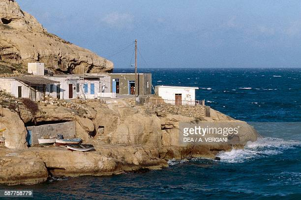 Fishermen houses on a rocky outcrop Gulf of Messara Matala Crete Greece