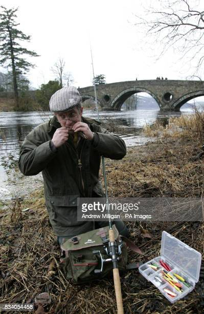 Fishermen Ian Bannerman from Tillicoultry ties his spinner on the river Tay at Kenmore on the first day of the Salmon Season