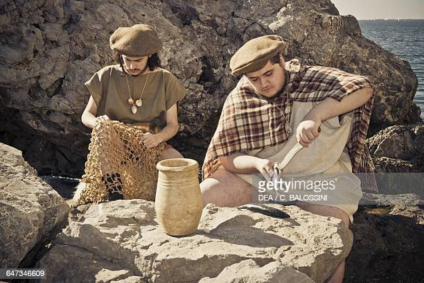 Fishermen mending nets and cleaning fish Illyrian civilisation mid3rd century BC Historical reenactment