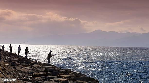 Fishermen near the sea in Reggio di Calalria,Calabria,Italy