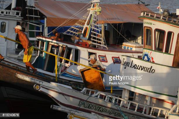Fishermen on the anchored boats in Amazon,Brazil