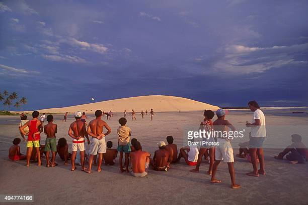 Fishermen play soccer in Jericoacoara beach Ceara State Brazil daily life in a fishing touristic village