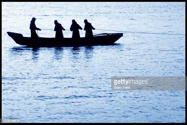 fishermen pulling in net.