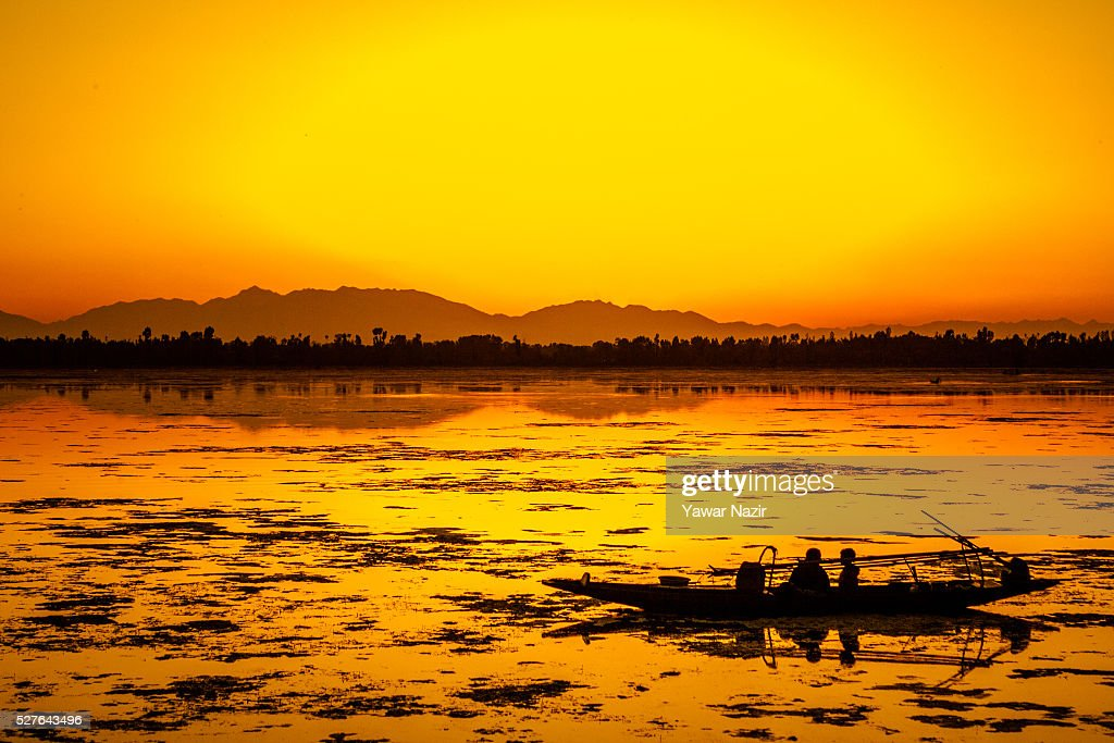 Fishermen resting in their Shikara boat are silhouetted against the setting sun Shikara at the Dal lake on May 03, 2016 Srinagar, the summer capital of Indian administered Kashmir, India. Kashmir the Muslim majority state , is known as the 'Paradise on Earth' and has for centuries captured the imagination of many writers, poets and film makers and is integral to the tourist trade. Kashmir has been a contested land between nuclear neighbors India and Pakistan since 1947, the year both the countries attained freedom from the British rule.