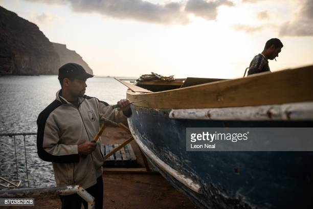 Fishermen Robin Stander and Wayne Yon continue renovation work on the boat 'Tina' on October 23 2017 in Jamestown Saint Helena The waters around the...