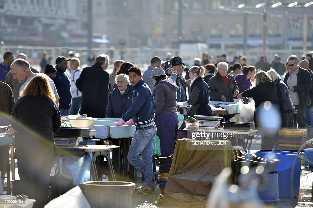 Fishermen sell fish on January 7, 2013 on the Vieux Port de Marseille (Marseille's old harbor), southern France, as part of urban renewal for 'Marseille-Provence European Capital of Culture' in 2013.