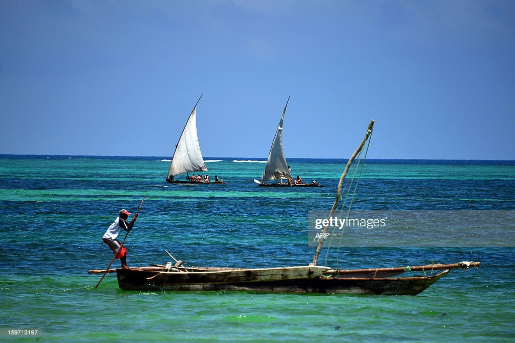 Fishermen stand on a sailing boat on January 8, 2013 in Zanzibar. AFP PHOTO / GABRIEL BOUYS