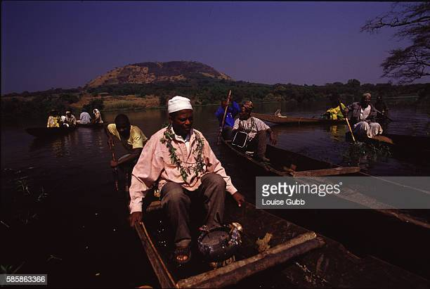 Fishermen transport their notables and spiritual leaders from Ndjindoun village out on to Lake Monoun to make offerings and speak to their ancestral...