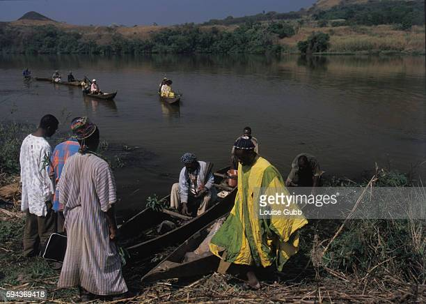 Fishermen transport their notables and spiritual leaders from Ndjindoun village out onto Lake Monoun to make offerings and speak to their ancestral...