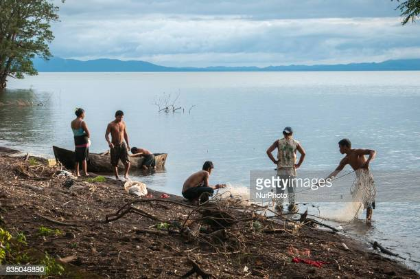 Fishermen untangle their nets on the shores of Lake Nicaragua a fresh water body that is being examined by Chinese engineers as a site for a second...