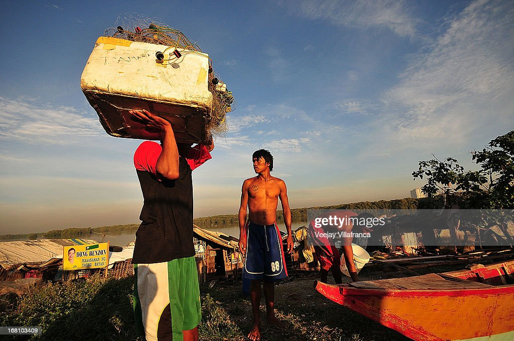 Fishermen who were former residents of Freedom Island prepare to head out into the bay on May 5, 2013 in Manila, Philippines. Around 13,000 hectares of the coastal area is to be recalimed and developed under the Public Private Partnership (PPP) of the Philippine government.