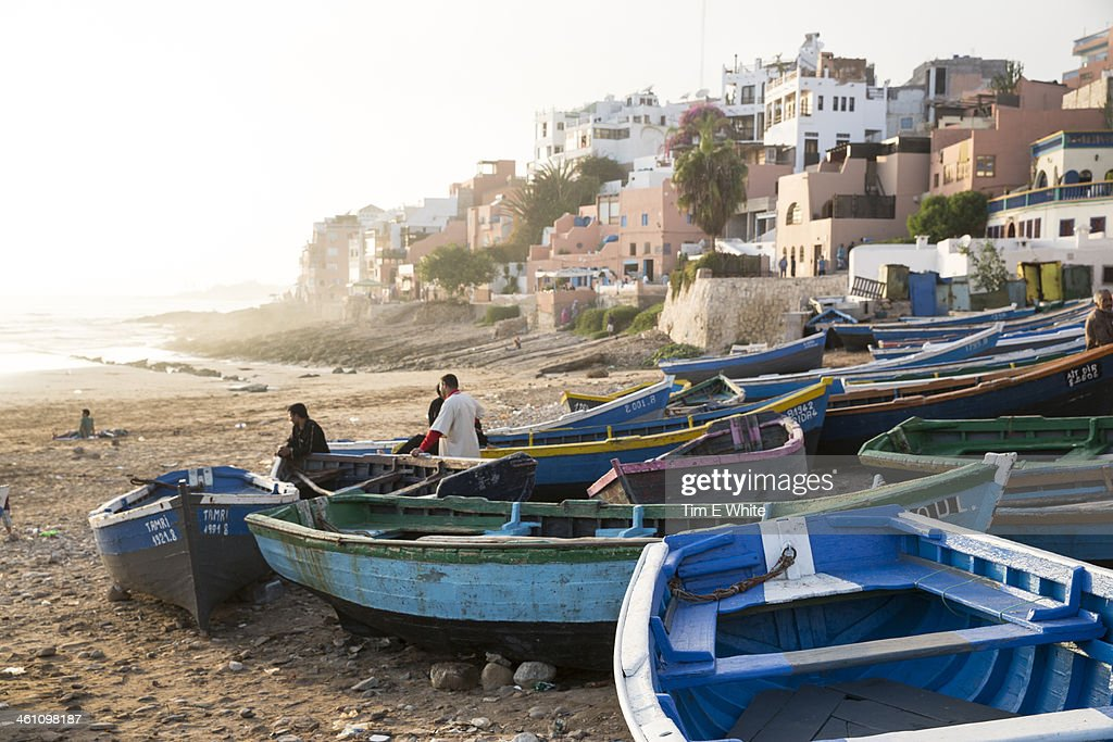 Fishermen with boats on the beach at Taghazout, Mo