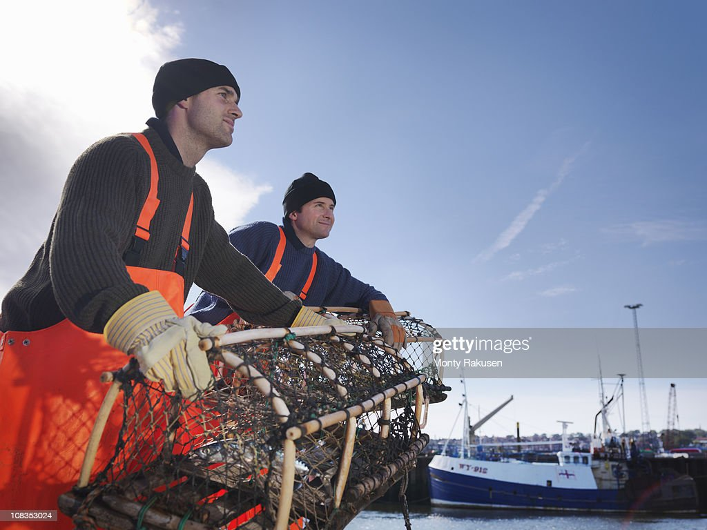 Fishermen with lobster pot