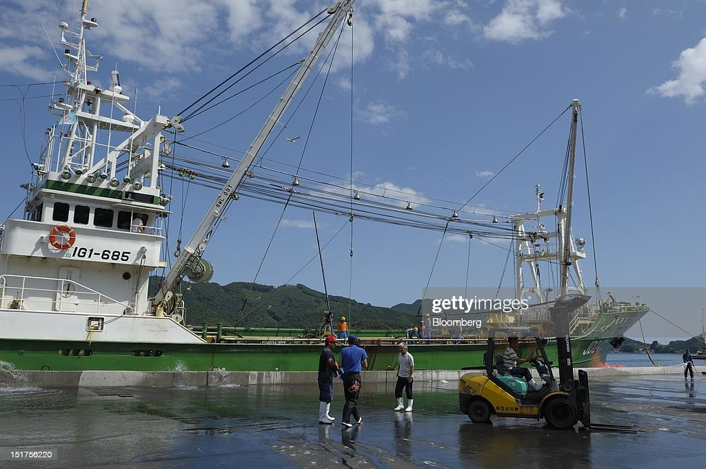 Fishermen work at a port in Ofunato City, Iwate Prefecture, Japan, on Friday, Sept. 7, 2012. Japan's economy expanded in the second quarter at half the pace the government initially estimated, underscoring the risk of a contraction as Europe's debt crisis caps exports.Photographer: Akio Kon/Bloomberg via Getty Images