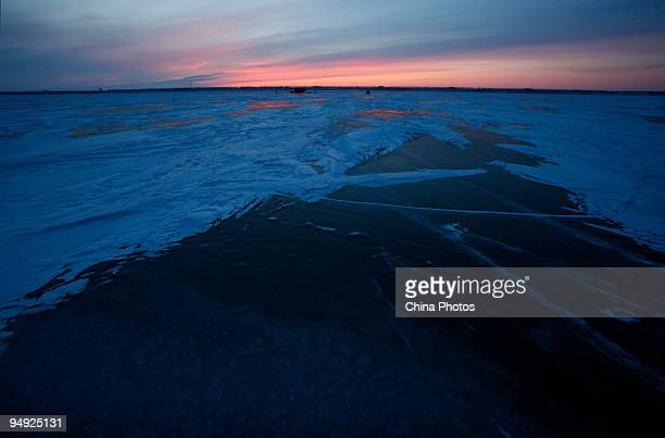 Fishermen work on the frozen Chagan Lake on December 19 2009 in Songyuan of Jilin Province northeast China Chagan Lake is one of the ten biggest...