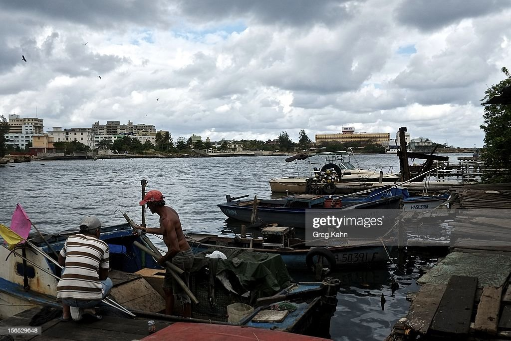 Fishermen work on their boats in one of the local docks November 16, 2012 in Havana, Cuba. Despite Cuba's fisheries being at critically low levels according to the United Nations, fishermen are still catching enough to make a living.