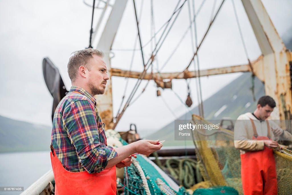 Fishermen working on fishing boat
