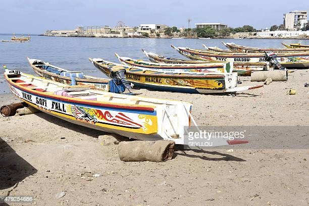 Fishermen's wooden pirogue are pictured at the traditional fishing harbour of Soumbedioune in Dakar on July 2 2015 The fishermen's colourful pirogues...