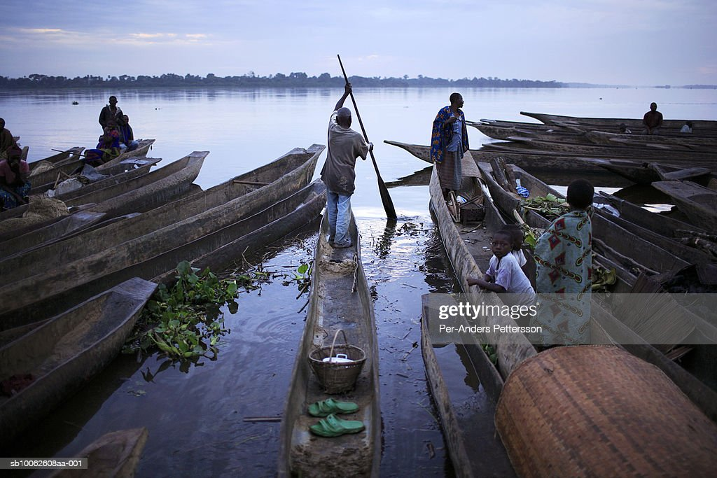 Fishernmen rowing canoes : Stock Photo