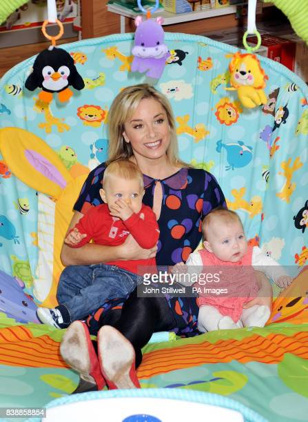 FisherPrice celebrity mum Tamzin Outhwaite tries out a giant baby bouncer by FisherPrice toys with Rudi Hayes aged 8 months and Ava Richardson aged 6...