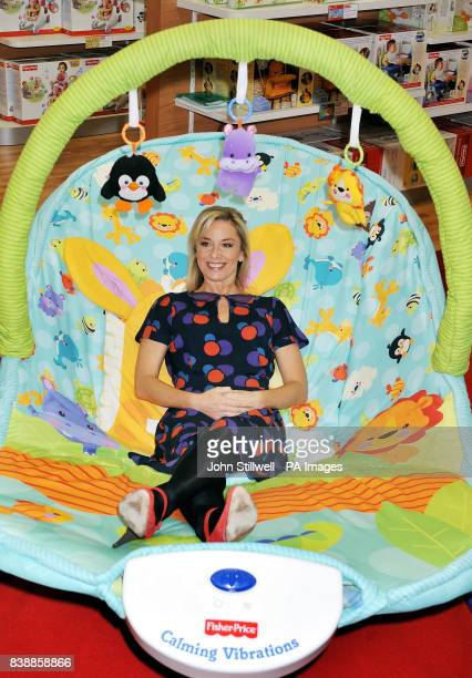 FisherPrice celebrity mum Tamzin Outhwaite tries out a giant baby bouncer by FisherPrice toys at the opening of The Baby Show running from today...