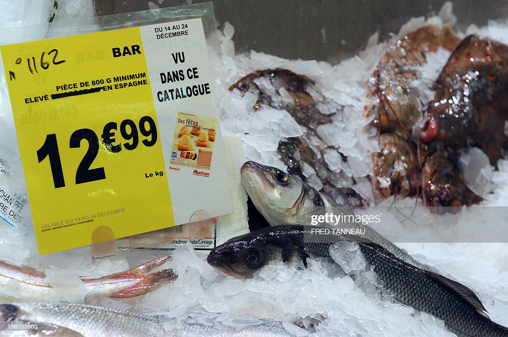 Fishes are seen at a stand of a supermarket Auchan on December 27, 2012 in Saint-Sebastien-sur-Loire, western France.