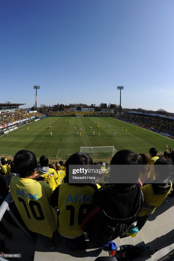 fish-eye Boys watch the game during the pre season friendly between Kashiwa Reysol and JEF United Chiba at Hitachi Kashiwa Soccer Stadium on February 17, 2013 in Kashiwa, Japan.