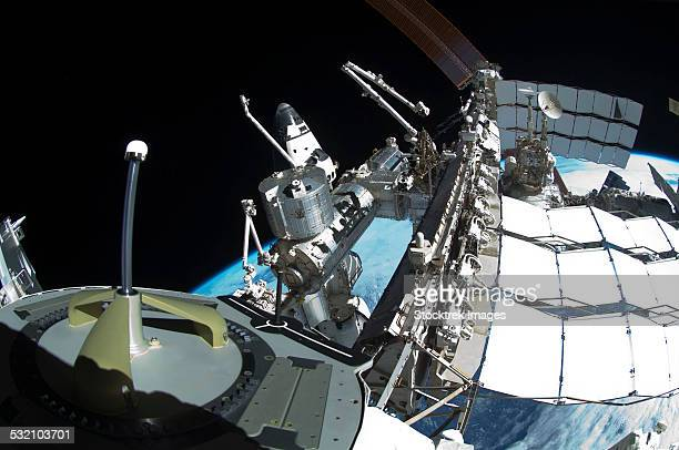 Fish-eye lens view of a portion of the International Space Station.