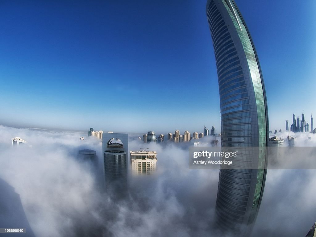 CONTENT] Fisheye of JLT and Dubai Marina from the 45th floor. Thick flog and low level cloud cover the area which a very rare site for the spring/summer. Main tower is Almas the second tallest tower in dubai. Second to burn Khalifa the world's tallest tower