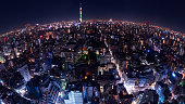 Fisheye view of  Night light cityscape view with modern building in Tokyo, Japan