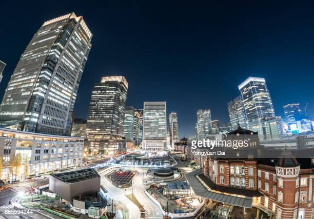 Fisheye View of Tokyo Station and Modern Skyscrapers at Night