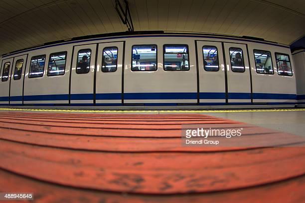 Fisheye view, train passing through Metro station.