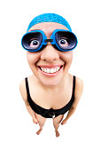 A fisheye image of a woman  with swimsuit and swimming goggles. Training in swimming, sports, competition concept isolated on white background.