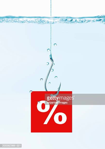 Fishhook with percentage sign in water