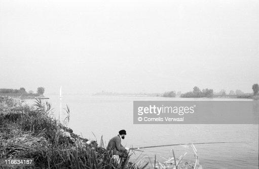 Fishing along De Lek : Foto de stock