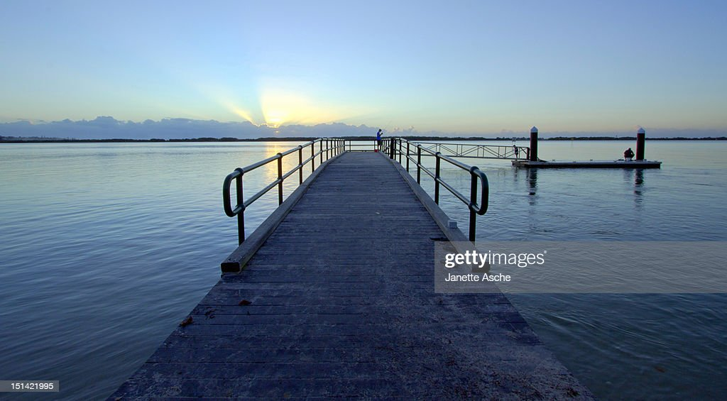 Fishing at sunrise : Stock Photo