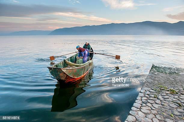 Fishing boat approaching dock, Dali, China