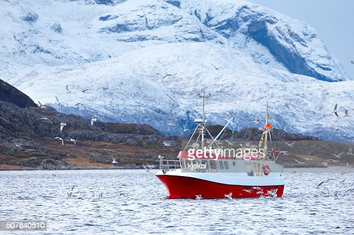 Fishing boat at sea in arctic environment : Stock Photo