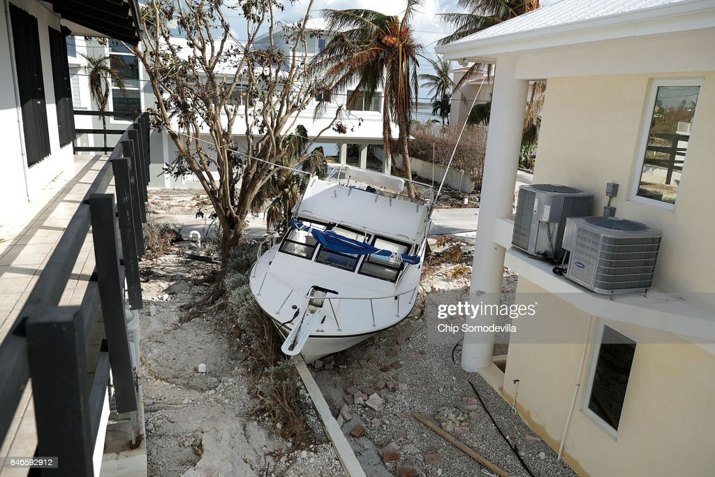 A fishing boat came to rest in between houses after being deposited there by Hurricane Irma's storm surge September 13, 2017 on Marathon, Florida. Many places in the Florida Keys still lack water, electricity or mobile phone service and residents are still not permitted to go further south than Mile Marker 73. The Federal Emergency Managment Agency has reported that 25-percent of all homes in the Florida Keys were destroyed and 65-percent sustained major damage when they took a direct hit from Hurricane Irma.