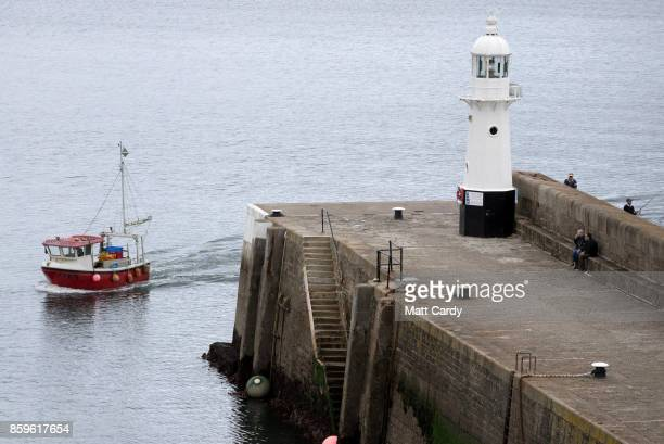 A fishing boat enters the harbour in the village of Mevagissey which has submitted plans to limit the number of second homes on October 9 2017 in...