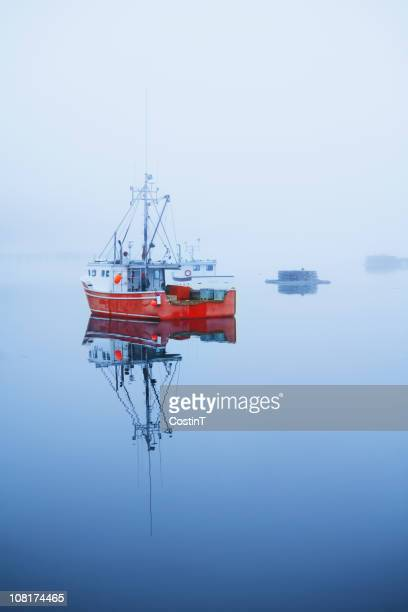 Fishing Boat in Foggy Water